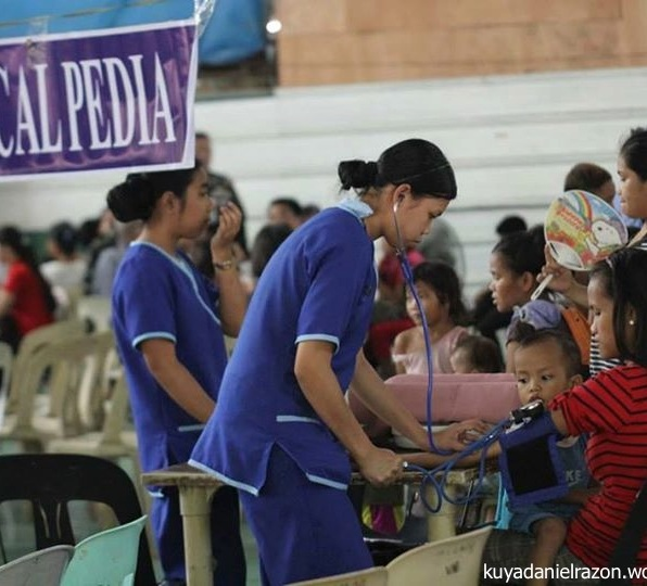 """Volunteer nurses talking to waiting patients and taking vital signs as part of the Standard Operating Procedure of the Free Medical Checkup during the UNTV Action Center """"People's Day"""" held in Pasay City last April 25, 2014."""